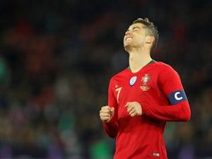 Luis Suarez plays down Ronaldo feud