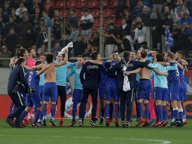 The Croatia players celebrate after securing their place at the 2018 World Cup