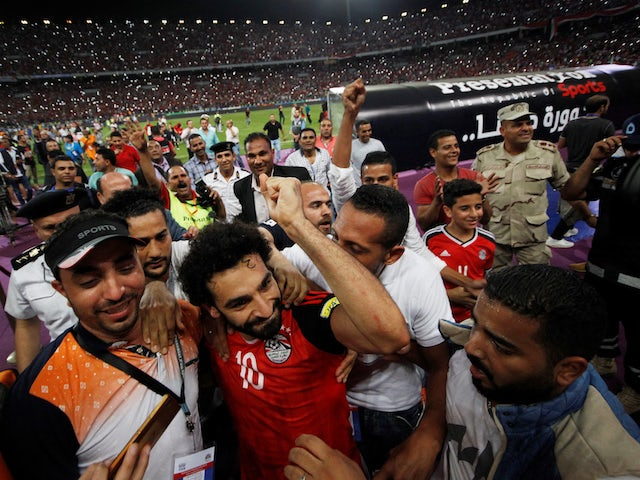 Egypt's Mohamed Salah celebrates with fans after scoring the goal which took his side to the 2018 World Cup