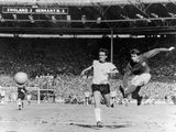 Sir Geoff Hurst scores England's fourth goal in the 1966 World Cup final