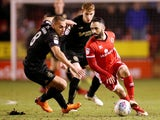 Walsall's Erhun Oztumer in action with Wigan Athletic's James Vaughan on March 21, 2018