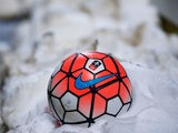 A football nestling in snow, sighted on January 19, 2016