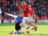 Barnsley's Oliver McBurnie in action with Sheffield Wednesday's Frederico Venancio on February 10, 2018