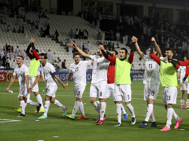 The Iran team celebrates after their World Cup qualifier with Qatar in June 2017