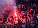 Liverpool fans light a flare inside the stadium before the Champions League semi-final second leg against Roma on May 2, 2018