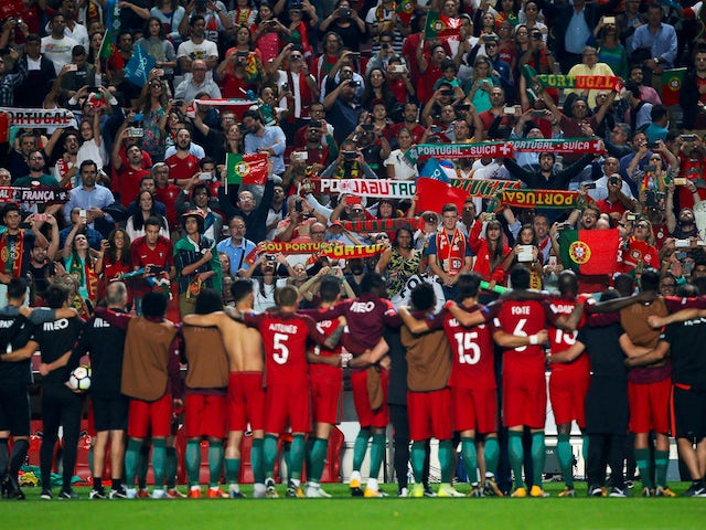 The Portugal players celebrate with their fans after their win over Switzerland in October 2017 which sealed their place at the 2018 World Cup