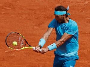 "Nadal ""happy"" to progress at Wimbledon"