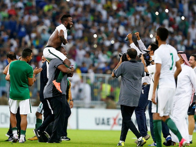 Saudi Arabia's players celebrate their qualification for the 2018 World Cup