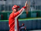 Ferrari's Sebastian Vettel celebrates qualifying in pole position for the Canadian Grand Prix on June 9, 2018