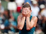 Simona Halep celebrates winning the French Open by hiding her face on June 9, 2018