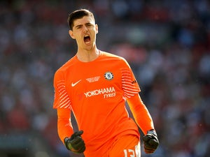 6fe3b5a711e Thibaut Courtois in action for Chelsea during the FA Cup final on May 19,  2018