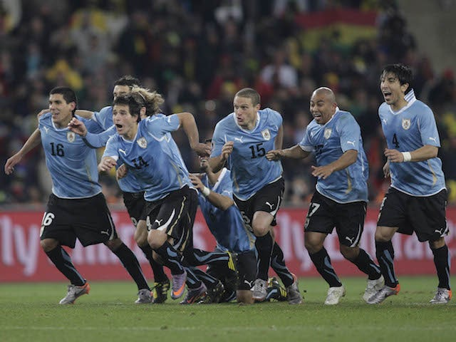 Uruguay's players celebrate their victory over Ghana on penalties in the quarter-finals of the 2010 World Cup