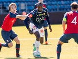 Jamaican sprint legend Usain Bolt and Norway's U19 player Fredrik Horn Myhre play in a friendly football match between Stromsgodset and Norway's U19 team at Marienlyst Stadium in Drammen, Norway, June 5, 2018.