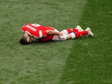 Russia forward Alan Dzagoev goes down injured during his side's World Cup Group A opener against Saudi Arabia at the Luzhniki Stadium in Moscow on June 14, 2018