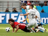 Amr Warda, Martin Caceres and Giorgian De Arrascaeta during the World Cup game between Egypt and Uruguay on June 15, 2018