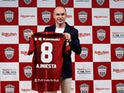 Andres Iniesta poses with the Vissel Kobe shirt after confirming his move to Japan on May 24, 2018