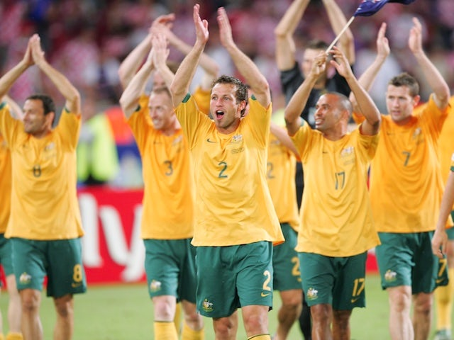 Australia celebrate after making it through to the knockout stages at the 2006 World Cup