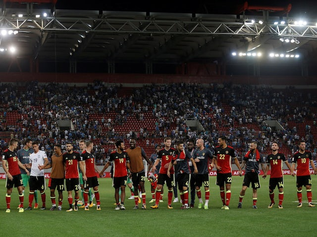 Belgium's players celebrate qualifying for the 2018 World Cup following a win over Greece