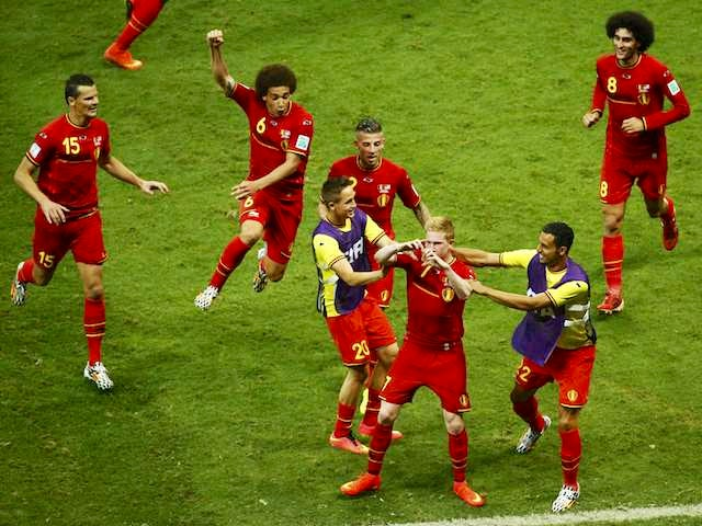 Belgium's players celebrate beating USA in the last 16 of the 2014 World Cup