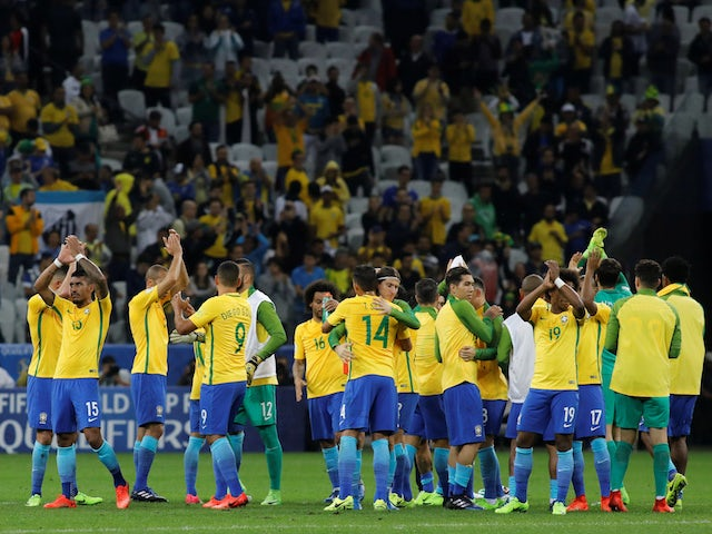 Brazil players celebrate after clinching qualification for the 2018 World Cup in Russia