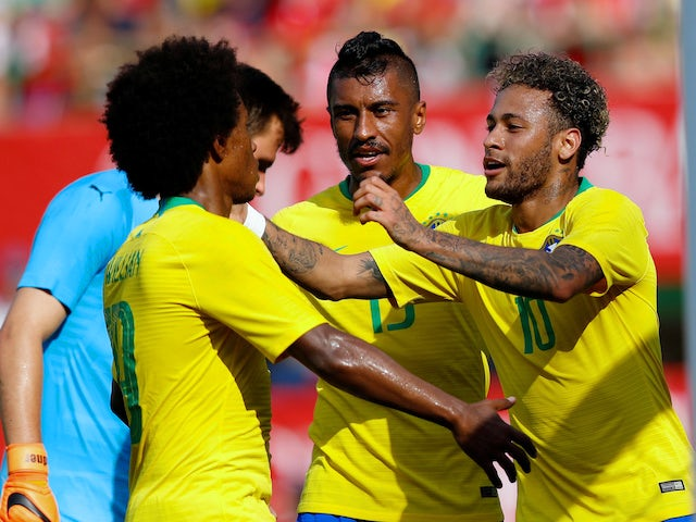 Neymar, Willian and Paulinho celebrate during Brazil's international friendly with Austria in June 2018