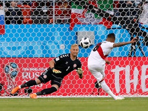Christian Cueva misses a penalty past Kasper Schmeichel during the World Cup group game between Peru and Denmark on June 16, 2018