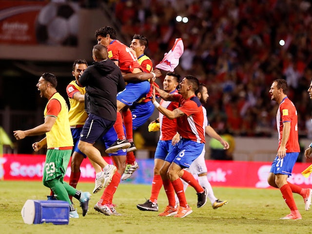 Costa Rica's players celebrate qualifying for the 2018 World Cup