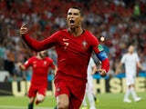Cristiano Ronaldo scores from the spot during the World Cup group game between Portugal and Spain on June 15, 2018