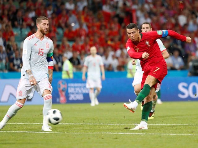 Cristiano Ronaldo scores his side's second during the World Cup group game between Portugal and Spain on June 15, 2018
