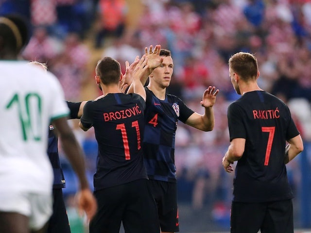 Croatian players Ivan Perisic, Marcelo Brozovic and Ivan Rakitic in action during the international friendly with Senegal on June 8, 2018