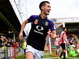Dan Potts celebrates scoring for Luton Town on November 11, 2017