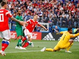 Denis Cheryshev scores the second during the World Cup opener between Russia and Saudi Arabia on June 14, 2018