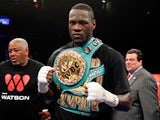 Deontay Wilder celebrates after knocking out Artur Szpilka in the ninth round of their heavyweight title boxing fight at Barclays Center in New York on January 16, 2017