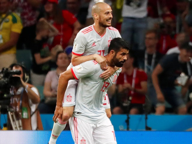 Diego Costa celebrates getting the equaliser with David Silva during the World Cup group game between Portugal and Spain on June 15, 2018