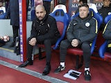 Manchester City assistant Domenec Torrent watches on with manager Pep Guardiola during a Premier League match in March 2018