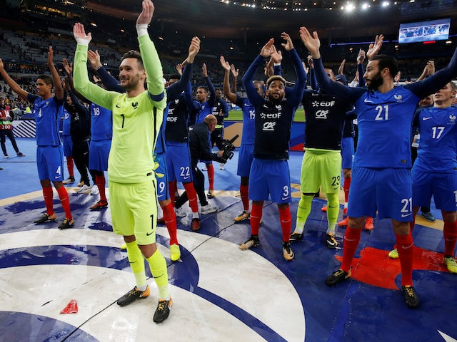 France's players celebrate qualifying for the 2018 World Cup in Russia
