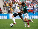 Germany's Joshua Kimmich in action with Mexico's Hirving Lozano on June 17, 2018