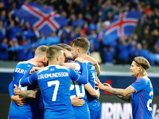 Iceland players celebrate during their international friendly with Norway on June 2, 2018