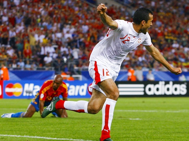 Jaouhar Mnari celebrates scoring the first goal for Tunisia against Spain at the 2006 World Cup
