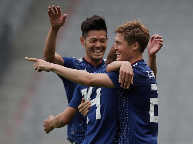 Japan players celebrate during their World Cup warm-up match against Paraguay on June 12, 2018