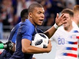 France's Kylian Mbappe celebrates scoring their first goal against USA on June 9, 2018
