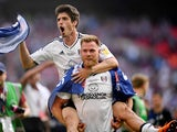 Lucas Piazon rides Tomas Kalas after Fulham secure promotion to the Premier League on May 26, 2018