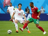 Medhi Benatia and Sardar Azmoun in action during the World Cup group game between Morocco and Iran on June 15, 2018