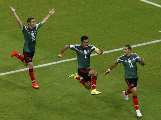 Mexico players celebrate beating Croatia at the 2014 World Cup