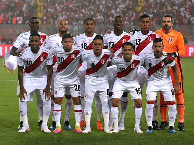 Peru line up before their international friendly with Scotland on May 30, 2018