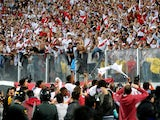 Peru players celebrate with fans after securing their place at the 2018 World Cup