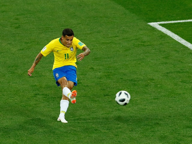 Brazil's Philippe Coutinho scores their first goal against Switzerland on June 17, 2018