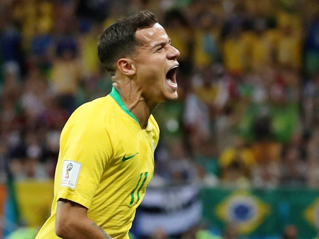 Brazil's Philippe Coutinho celebrates scoring their first goal in the match against Switzerland on June 17, 2018