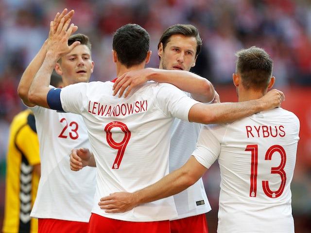 Robert Lewandowski celebrates scoring during Poland's international friendly with Lithuania on June 12, 2018