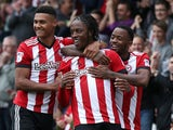Brentford's Romaine Sawyers celebrates scoring their first goal against Millwall on October 14, 2017